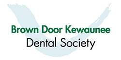 brown door kewaunee dental society logo